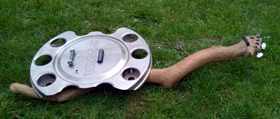 I made this 5 string hubcap and driftwood guitar in Jan 2014