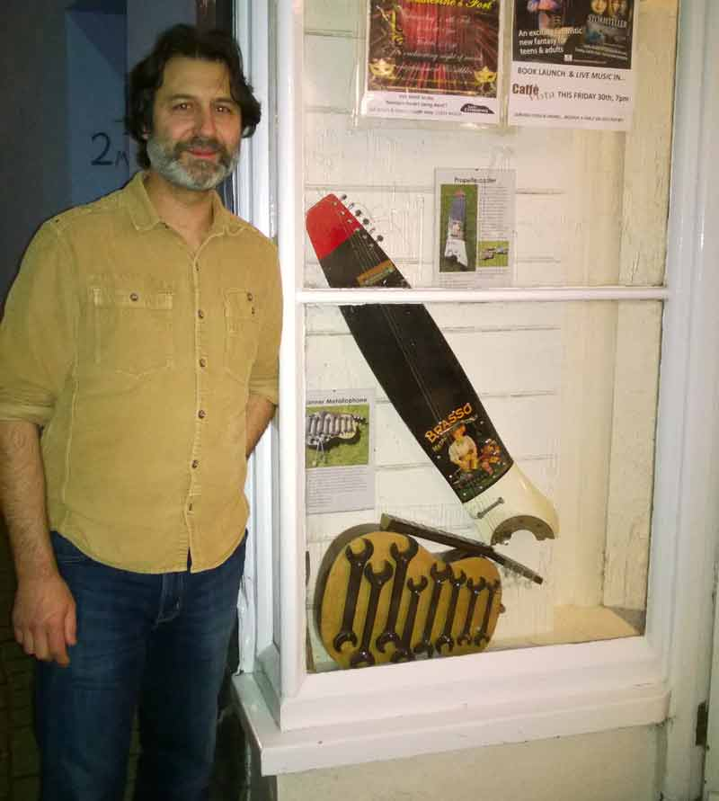 Yanni Hrysicos of Caffe Vista, Tenby with upcycled musical instruments Propellercaster and Spanner Metallophone