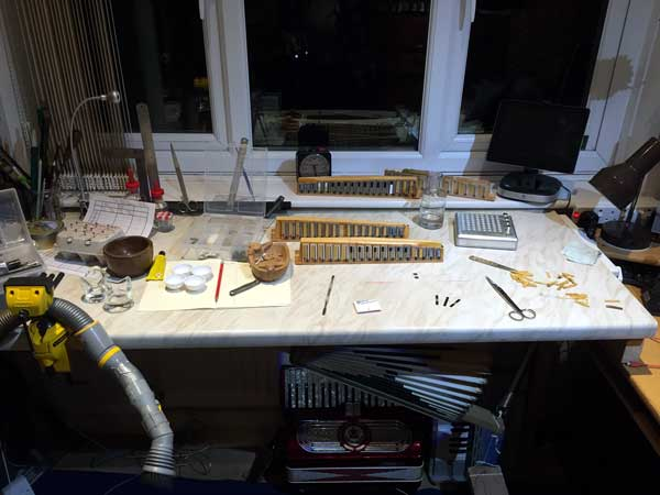 Accordion repair workbench - notice the bellows fitted underneath for quick testing of reed blocks outside the accordion